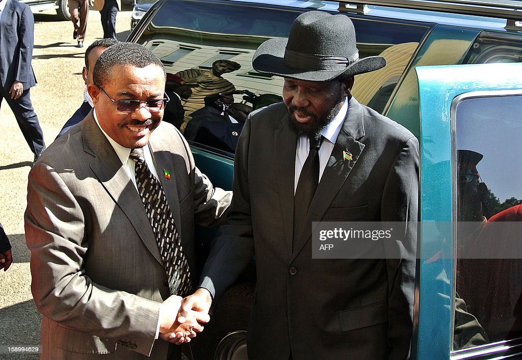 Ethiopian Prime Minister Hailemariam Desalegn (L) greets the President of South Sudan Salva Kiir in Addis Ababa on January 5, 2013, ahead of a Presidential summit between Kiir and his Sudanese counterpart. The rival presidents of Sudan and South Sudan met for face-to-face talks on January 5 to push forward stalled security, oil and border deals, and to discuss the fate of the contested Abyei region. Sudanese President Omar al-Bashir and his Southern counterpart Salva Kiir met alongside African Union mediator Thabo Mbeki, while tensions remain high after the latest in a string of accusations that Khartoum had bombed South Sudan. Ethiopian Prime Minister Hailemariam Desalegn, who is hosting the talks, also attended the first meeting between the former civil war foes for over three months, when they signed a raft of key deals that have yet to be implemented. AFP PHOTO/JENNY VAUGHAN