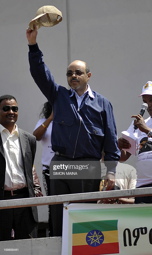 Ethiopian Prime Minister Meles Zenawi salutes supporters on Meskel Square in Addis Ababa on May 25, 2010 as he celebrates a landslide election victory, which the opposition slammed as fraudulent and European observers as unfair. Tens of thousands of ruling party supporters thronged the city square after the electoral commission released preliminary results late on May 24, showing the ruling coalition had a wide lead across the country. But the oppposition charged the 55-year-old strongman, who has ruled sub-Saharan Africa's second most populous country for two decades, had rigged his way to re-election in the May 23 polls.