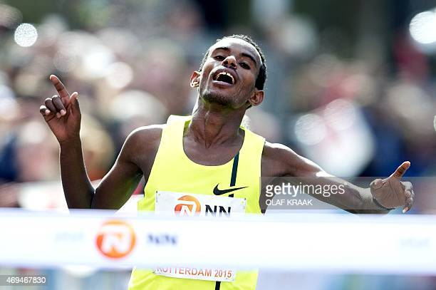 Ethiopian runner Abera Kuma reacts as he crosses the finish line to win the Rotterdam Marathon on April 12 2015 in Rotterdam AFP PHOTO / ANP / OLAF...