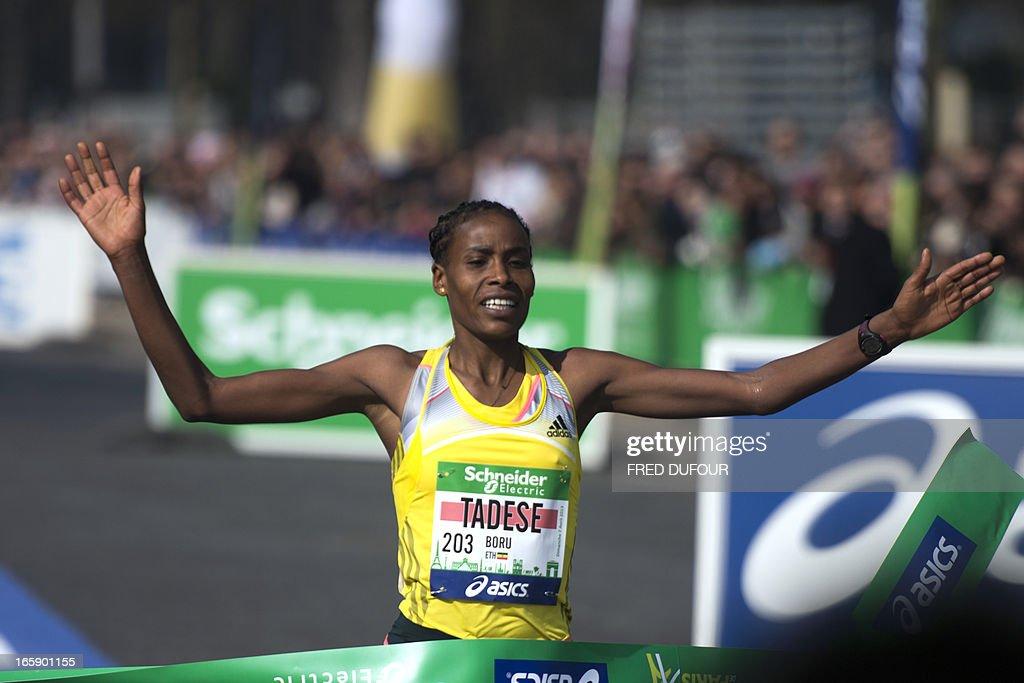 Ethiopian Tadese Boru crosses the finish line to win the 37th edition of the Paris Marathon on April 7, 2013 in Paris.