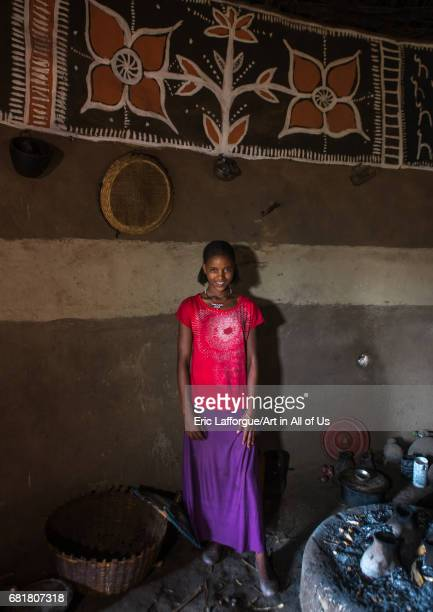 Ethiopian teenage girl inside her traditional painted and decorated house Kembata Alaba Kuito Ethiopia on March 9 2016 in Alaba Kuito Ethiopia