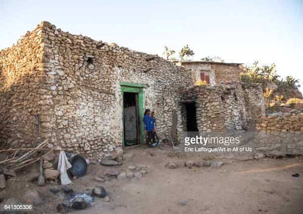 Ethiopian woman with her child in front of a traditional Argoba stone houses village on January 12 2017 in Koremi Ethiopia