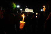 Ethiopians take part in a candlelight vigil in front of the White House in Washington on October 25 2009 Dozens of Ethiopians and their supporters...