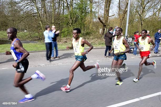 Ethiopia's Abera Kuma and Kenya's Mark Kiptoo compete in the Rotterdam Marathon on April 12 2015 in Rotterdam Kuma won the race AFP PHOTO / ANP /...