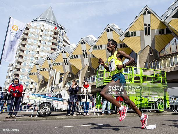 Ethiopia's Abera Kuma competes to first place in the Rotterdam Marathon on April 12 2015 in Rotterdam AFP PHOTO / ANP / MARCO DE SWART **NETHERLANDS...