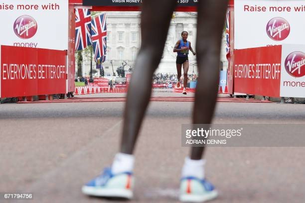 Ethiopia's Aselefech Mergia arrives in third place in the women's elite race at the London marathon on April 23 2017 in London Kenya's Mary Keitany...