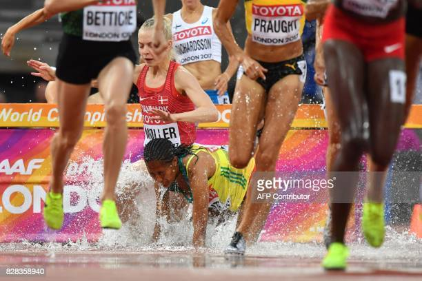 TOPSHOT Ethiopia's Birtukan Fente falls while competing in the women's 3000m steeplechase athletics event at the 2017 IAAF World Championships at the...