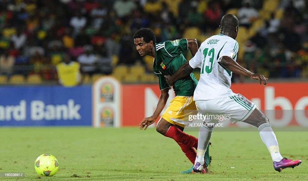 Ethiopia's defender Abebaw Butako vies with Nigeria's midfielder Fegor Ogude during the 2013 Africa Cup of Nations Group C match at the Royal Bafokeng stadium in Rustenburg on January 29, 2013.