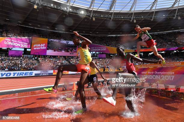 Ethiopia's Getnet Wale Kenya's Jairus Kipchoge Birech and Algeria's Bilal Tabti compete in the heats of the men's 3000m steeplechase athletics event...