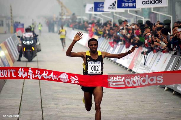 Ethiopia's Girmay Birhanu Gebru wins the 34th Beijing International Marathon in a time of two hours 10 minutes and 42 seconds in Beijing on October...
