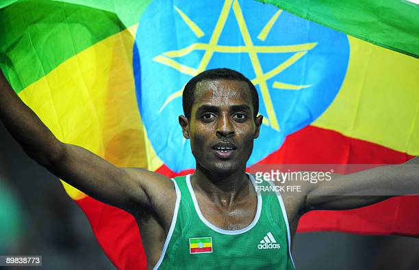 Ethiopia's Kenenisa Bekele celebrates his victory the men's 10000m final race of the 2009 IAAF Athletics World Championships on August 17 2009 in...