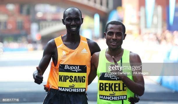 Ethiopia's Kenenisa Bekele celebrates with Kenya's Wilson Kipsang after winning the BUPA Great Manchester Run Manchester