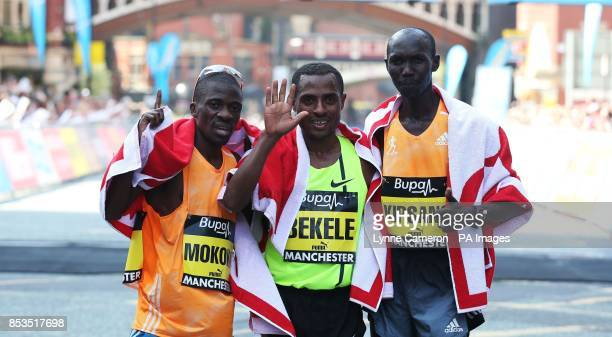Ethiopia's Kenenisa Bekele celebrates with Kenya's Wilson Kipsang and South Africa's Stephen Mokoka after winning the BUPA Great Manchester Run...