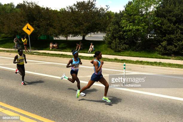 Ethiopia's Mamitu Dasaka F16 in front and her teammate Ruti Aga F17 middle keep a fast pace with Kenya's Gladys Kipsoi F12 keeping pace left during...