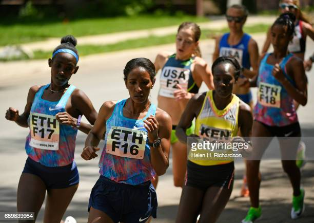 Ethiopia's Mamitu Dasaka F16 in front and her teammate Ruti Aga F17 left keep a fast pace with Kenya's Gladys Kipsoi F12 keeping pace right during...