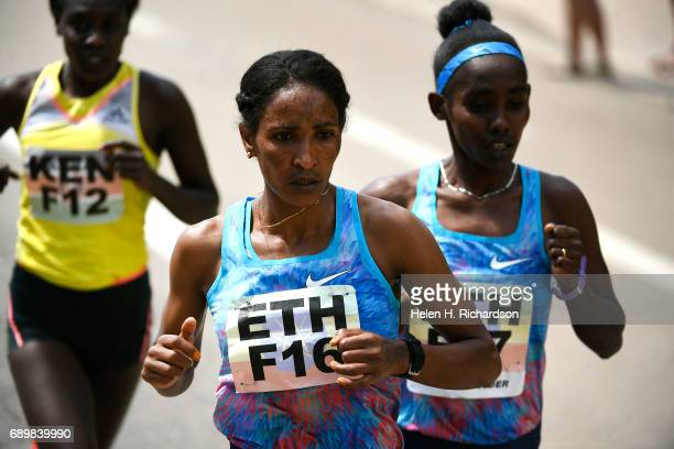 Ethiopia's Mamitu Dasaka F16 in front and her teammate Ruti Aga F17 right keep a fast pace with Kenya's Gladys Kipsoi F12 keeping pace left during...