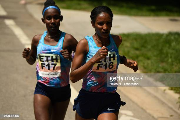 Ethiopia's Mamitu Dasaka F16 right and her teammate Ruti Aga F17 stay neck and neck during the women's elite race of the 39th annual Bolder Boulder...
