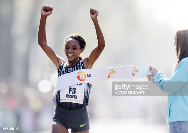 Ethiopia's Meskerem Assefa crosses the finish line to win the womens' race of the 37nd edition of the Rotterdam Marathon in Rotterdam on April 9 2017...