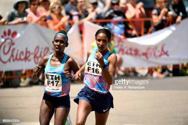 Ethiopia's Ruti Aga F17 left and her teammate Mamitu Dasaka F16 right set a fast pace during the women's elite race of the 39th annual Bolder Boulder...