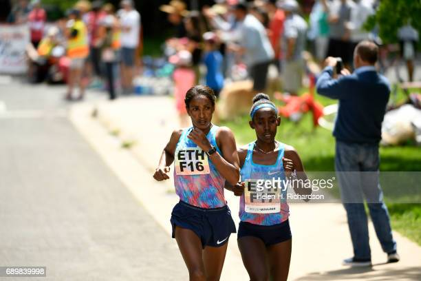Ethiopia's Ruti Aga F17 right and her teammate Mamitu Dasaka F16 set a fast pace during the women's elite race of the 39th annual Bolder Boulder on...