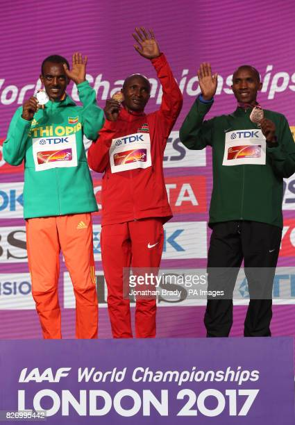 Ethiopia's Tamirat Tola Kenya's Geoffrey Kirui and Tanzania's Felix Simbu during day three of the 2017 IAAF World Championships at the London Stadium