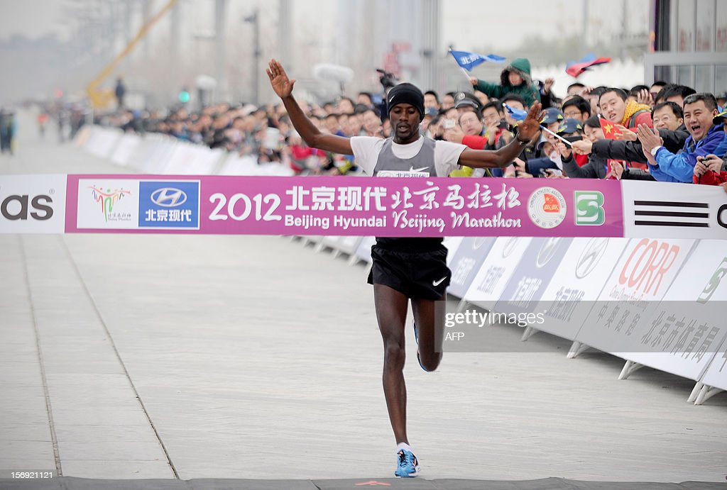 Ethiopia's Tariku Jufar Robi crosses the finish line to win the men's portion of the Beijing Marathon in the Chinese capital on November 25, 2012. A total of 30,000 runners took part in the race.