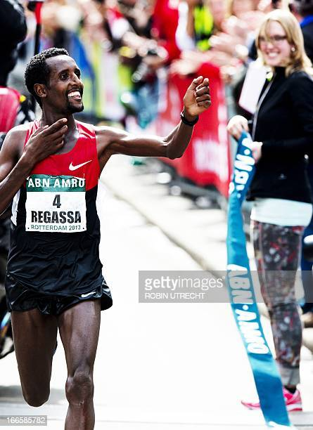 Ethiopia's Tilahun Regassa celebrates as he crosses the finish line to win the Rotterdam Marathon on April 14 2013 in Rotterdam OUT