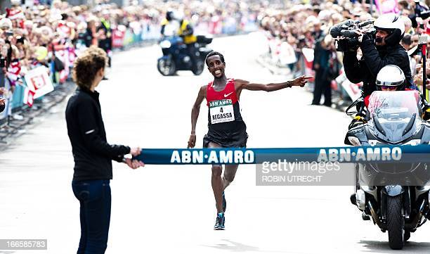 Ethiopia's Tilahun Regassa celebrates as he crosses the finish line to win the Rotterdam Marathon on April 14 2013 in Rotterdam OUT