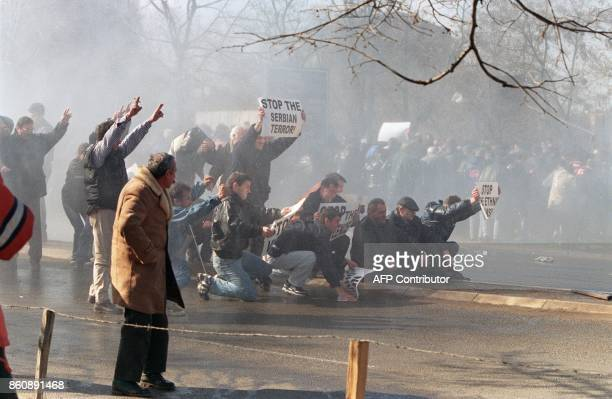 Ethnic Albanian demonstrators try to brave water canons used by Serbian riot police to disperse an antiBelgrade protest of tens of thousands of...