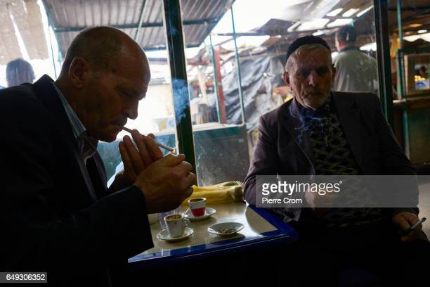 Ethnic Albanian men drink coffee in the bazar on March 7 2017 in Skopje Macedonia The political crisis deepens as the president refused to grant the...