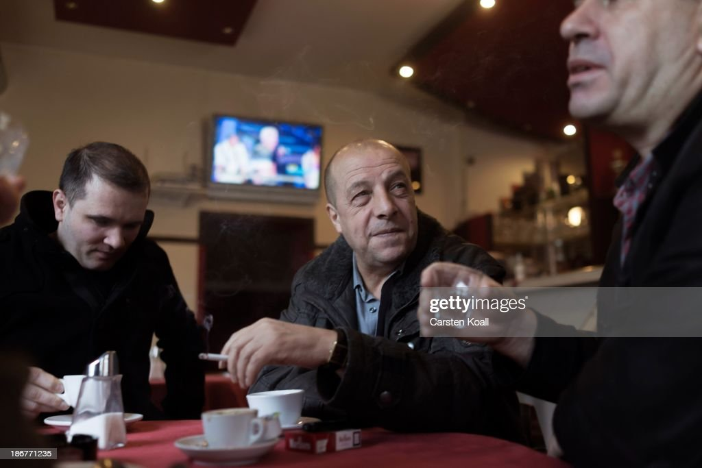 Ethnic Albanian men Nuhi Kaili (R) and Mustafer Iseni (C) sit with Albanian friends in an Albanian pub Radush at Sonnenallee in Neukoelln district on November 02, 2013 in Berlin, Germany. This pub is named after the Albanian village Radush in Macedonia. The men came to Germany, along with around two hundred other families from the same village. According to recently published statistics, 7.2 million foreigners were living in Germany by the end of 2012, which is the highest number ever recorded. Of those 80% are from countries in the European Union, while the rest come primarily from Turkey, Russia, the former Soviet states and Arab countries.