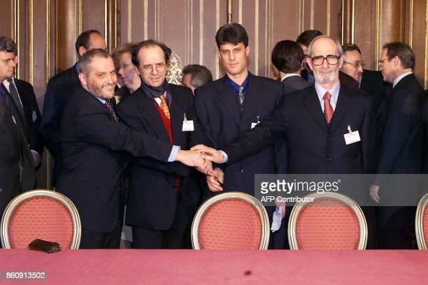 Ethnic Albanian negotiators at the Kosovo peace talks Veton Surroi Ibrahim Rugova Hashim Thaci and Rexhep Qosja shake hands at the International...