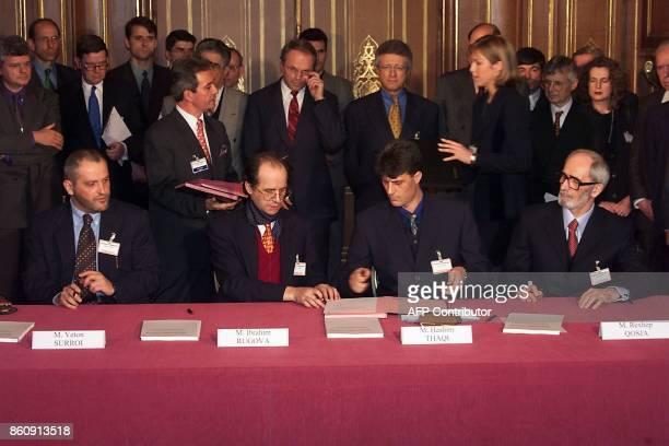 Ethnic Albanian negotiators at the Kosovo peace talks Veton Surroi Ibrahim Rugova Hashim Thaci Rexhep Qosja sign a draft accord hammered out last...