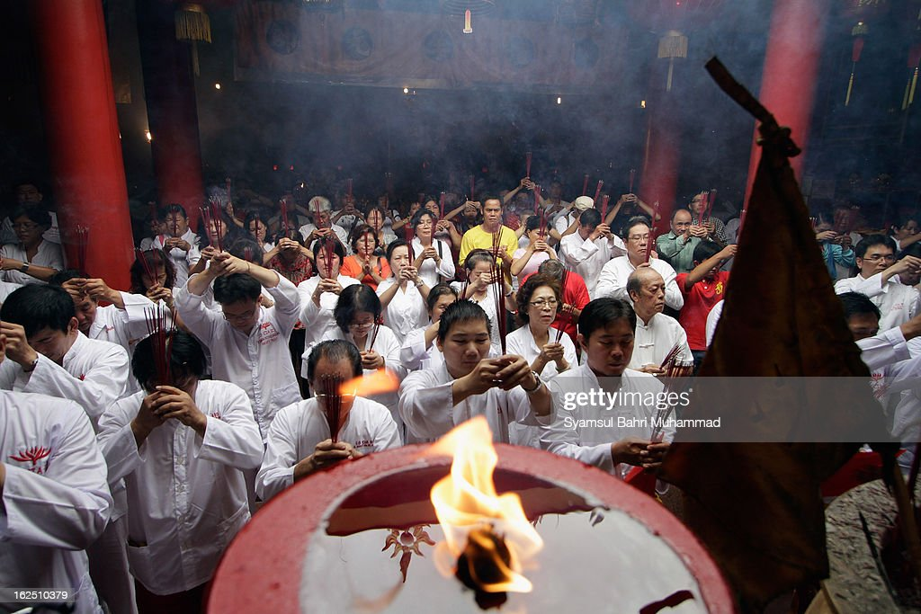 Ethnic Chinese Indonesians recite prayers during Chap Goh Meh celebrations at a temple on February 24, 2013 in Jakarta, Indonesia. Today locals are celebratinh the Chap Goh Meh, which is the 15th day of Chinese New Year and represents the end of the Chinese New Year celebrations. Traditionally,people visit temples and offer prayers in order to receive blessings and good fortune from the God of Prosperity.