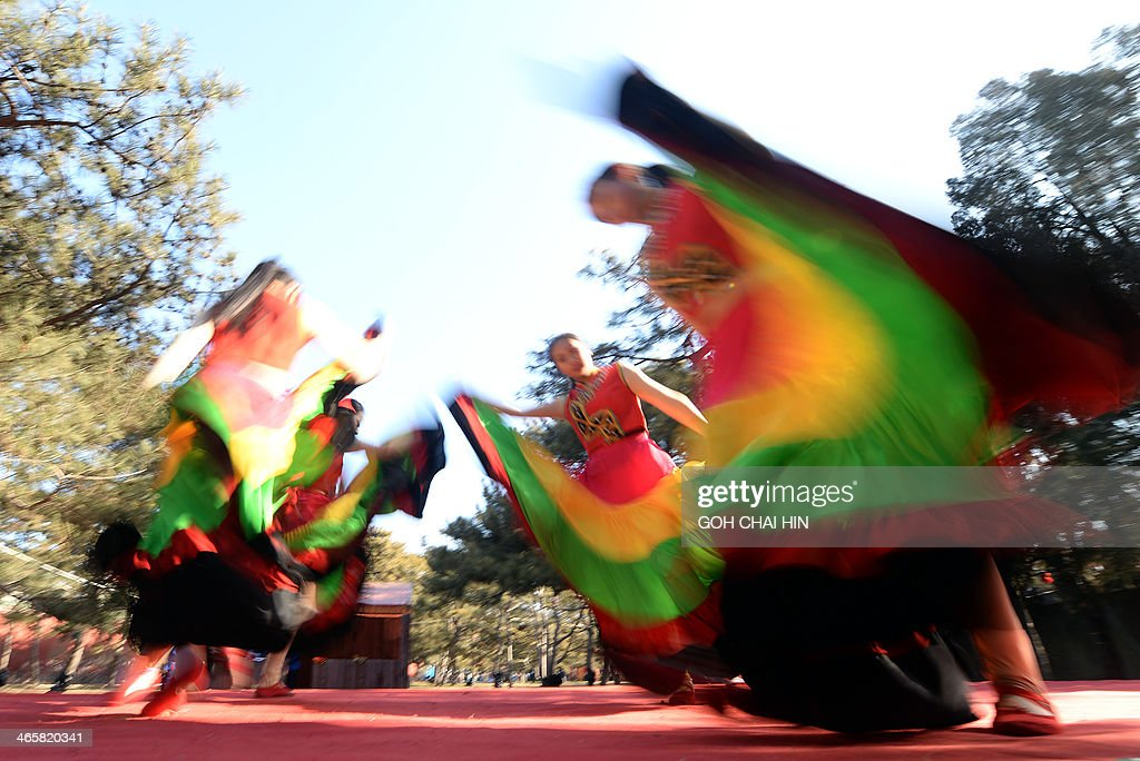 Ethnic dancers from southwest China's Yunnan province perform at the Ditan park temple fair in Beijing on January 30, 2014, on the eve of the Lunar New Year. Over a billion Chinese in China and millions more all over the world will be celebrating the Lunar New Year, known as the Spring Festival in China.