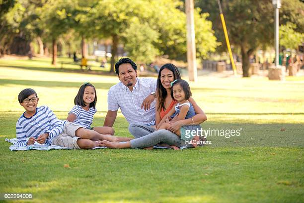 Ethnic family enjoying a local park