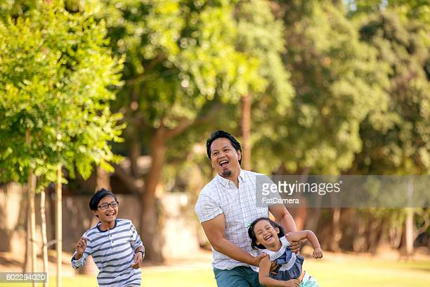 Ethnic father playing with his children