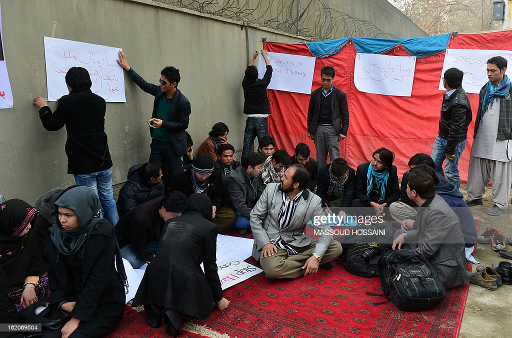 Ethnic Hazara Afghan Shiite Muslims prepare for a hunger strike, in protest against the February 16 bombing in Pakistan targeting Shiites that killed 89 people, in Kabul on February 19, 2013. The hunger strikers began their fast in front of the UN office in the Afghan capital in reaction to the attack on the outskirts of the southwestern Pakistani city of Quetta, where thousands of Shiites are demanding army protection and refusing to bury the victims of Saturday's bomb attack on their ethnic Hazara community. AFP PHOTO/ Massoud HOSSAINI