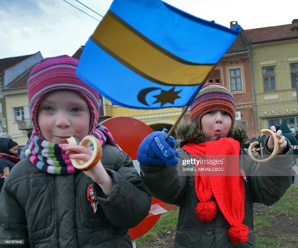 Ethnic Hungarian children wave a Szekler flag during a parade on Hungary's National Day in Targu Secuiesc (250km north of Bucharest) on March 15, 2013. Thousands of ethnic Hungarians from the central Transylvanian region of Romania gather in a celebration in Targu Secuiesc to mark the 1848 Hungarian Revolution.