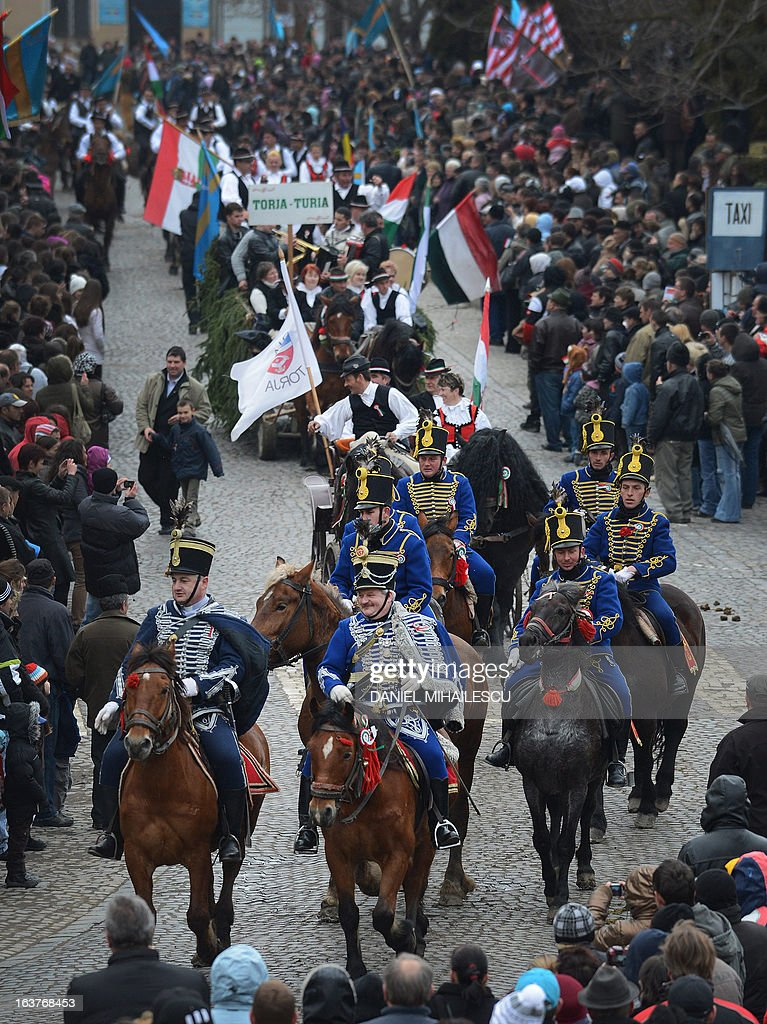 Ethnic Hungarian wear huszar outfits as they ride during a parade on Hungary's National Day in Targu Secuiesc (250km north of Bucharest) on March 15, 2013. Thousands of ethnic Hungarians from the central Transylvanian region of Romania gather in a celebration in Targu Secuiesc to mark the 1848 Hungarian Revolution. AFP PHOTO / DANIEL MIHAILESCU