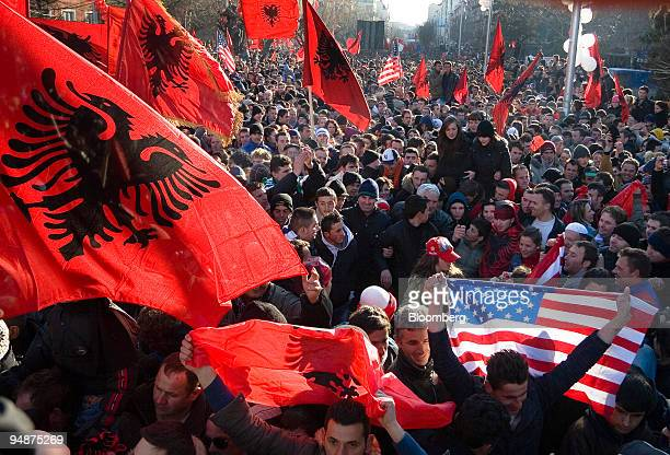 Ethnic Kosovo Albanians wave the American and Albanian flags as they celebrate in Pristina Kosovo on Sunday Feb 17 2008 Kosovo declared independence...