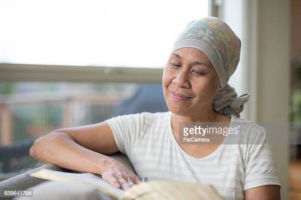 Ethnic mature adult with cancer reading the bible
