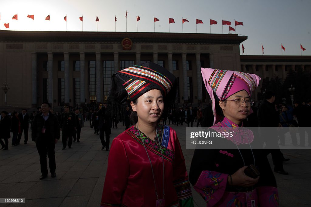 Ethnic minority delegates leave the opening session of the Chinese People's Political Consultative Conference (CPPCC) at the Great Hall of the People in Beijing on March 3, 2013. Thousands of delegates from across China meet this week to seal a power transfer to new leaders whose first months running the Communist Party have pumped up expectations with a deluge of propaganda. AFP PHOTO / Ed Jones