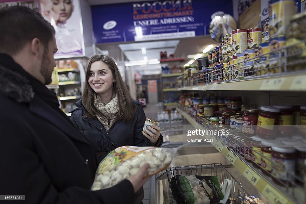 Ethnic mixed couple Russian Natalia Peregudova (R) and German Joe Henson (L) look for goods in the Russian supermarket 'Rossia' in Charlottenburg district on November 03, 2013 in Berlin, Germany. Moscovian Natalia Peregudova moved to Germany 15 years ago. According to recently published statistics, 7.2 million foreigners were living in Germany by the end of 2012, which is the highest number ever recorded. Of those 80% are from countries in the European Union, while the rest come primarily from Turkey, Russia, the former Soviet states and Arab countries.