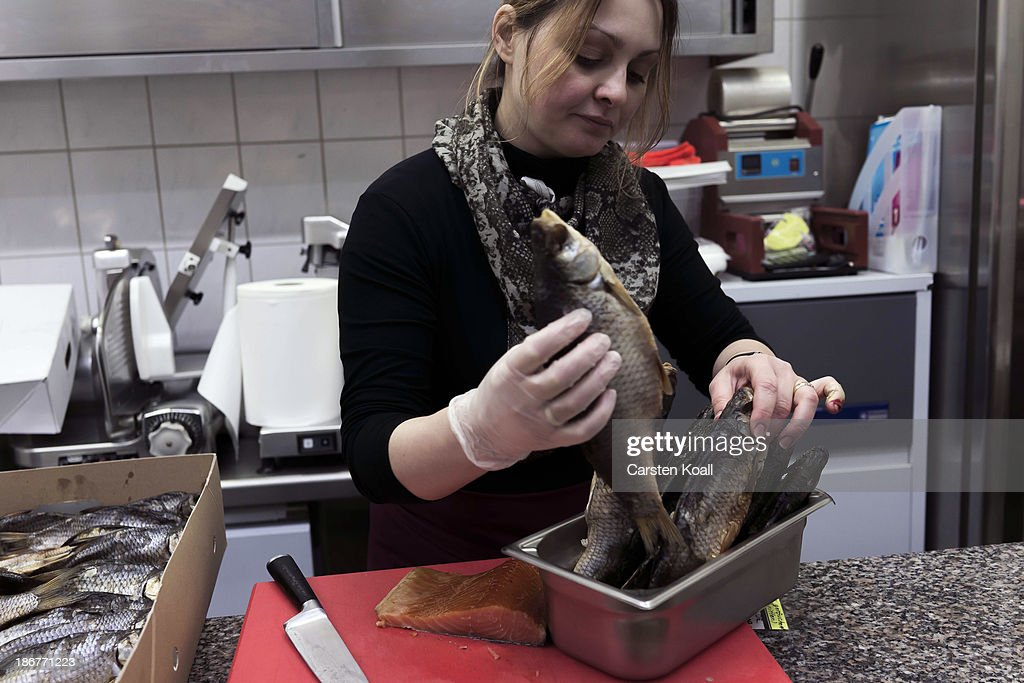 Ethnic Moldovian Vera Mita prepares fish and caviar at the fish counter in the Russian supermarket 'Rossia' in Charlottenburg district on November 03, 2013 in Berlin, Germany. Vera Mita left Moldova 15 years ago to Ireland and lives now since two month in Berlin. According to recently published statistics, 7.2 million foreigners were living in Germany by the end of 2012, which is the highest number ever recorded. Of those 80% are from countries in the European Union, while the rest come primarily from Turkey, Russia, the former Soviet states and Arab countries.