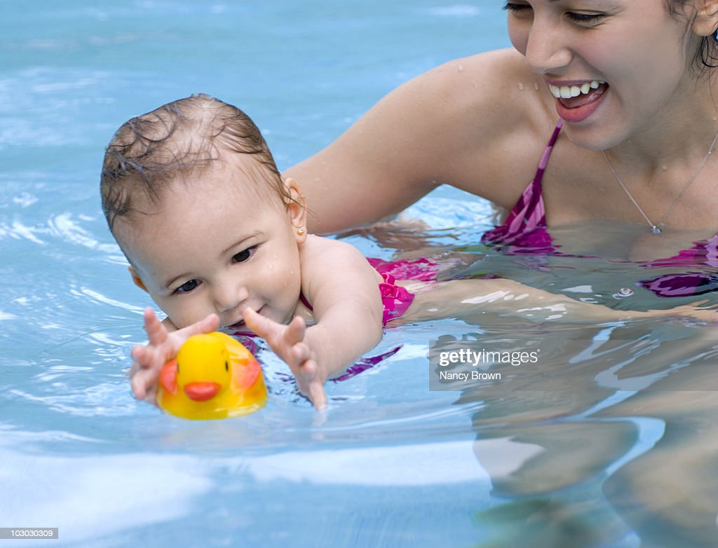 Ethnic Mother Teaching Baby To Swim Stock Photo   Getty Images