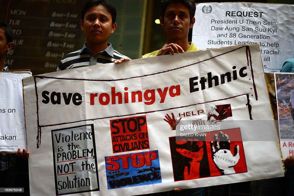 Ethnic Myanmar activists hold a placard during a protest against the Myanmar army in front of the Australia Department of Foreign Affairs and Trade (DFAT) in Sydney on March 19, 2013. Scores of Myanmar activists gathered in front of the DFAT and demanded Australian government to take a strong stance against ongoing human rights abuses in Myanmar and to condemn military attacks in Kachin state in northern Myanmar and ethnic violence against ethnic Rohingya Muslims. President Thein Sein is visiting Australia from 17 to 20 March and is the first by a head of state of Myanmar since 1974. AFP PHOTO / Saeed Khan