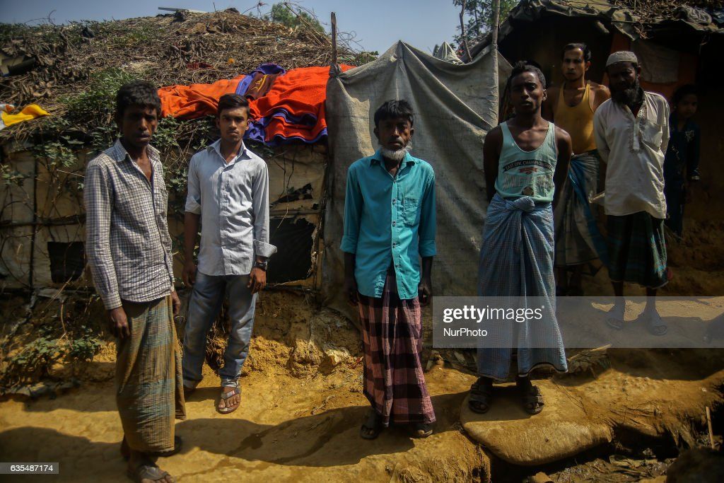 Ethnic of minority of Rohingya community stand outside their makeshift refugess camp in Kutupalong , Bangladesh on February 15, 2017. Almost 60,000 thousand refugees from Maungdaw, Myanmar living in makeshift camp after conflict in Rakhine state started October last year flee to Kutupalong in Bangladesh. More than 31 Non-goverment organisations (NGO) include Mapim and Kelab Putra 1 Malaysia from Malaysia, Indonesia, China, France, Germany, and United States joint forces bringing almost 2300 tonne of humanitarian goods include medicine, food, cooking oil and cloth were sending to ethnic minority Rohingya in Yangon and Teknaf.
