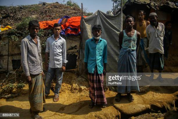 Ethnic of minority of Rohingya community stand outside their makeshift refugess camp in Kutupalong Bangladesh on February 15 2017 Almost 60000...