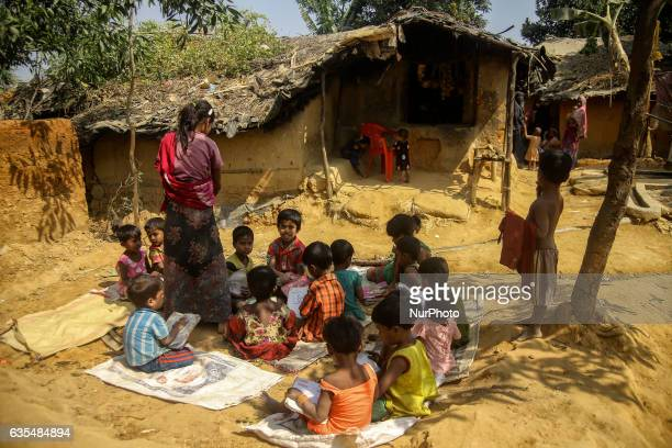 Ethnic of minority Rohingya children are seen playing in front of their makeshift refugees camp in Kutupalong Bangladesh on February 15 2017 Almost...